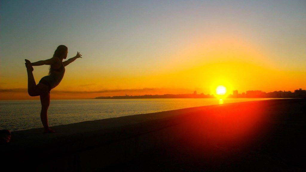 Yoga at sunrise on El Malecon in Havana, Cuba